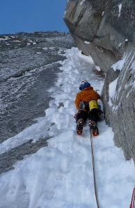 Arc'teryx Gamma Guide Pant, perfect for Alpine climbing. Seen here being used on the first crux of Beyond Good and Evil, North Face of Aiguille du Pelerins, France.
