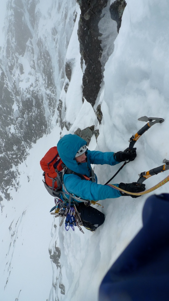 Kasia having just pulled over the crux bulge and approaching the belay at the end of pitch 2 on Observatory Buttress, Ben Nevis