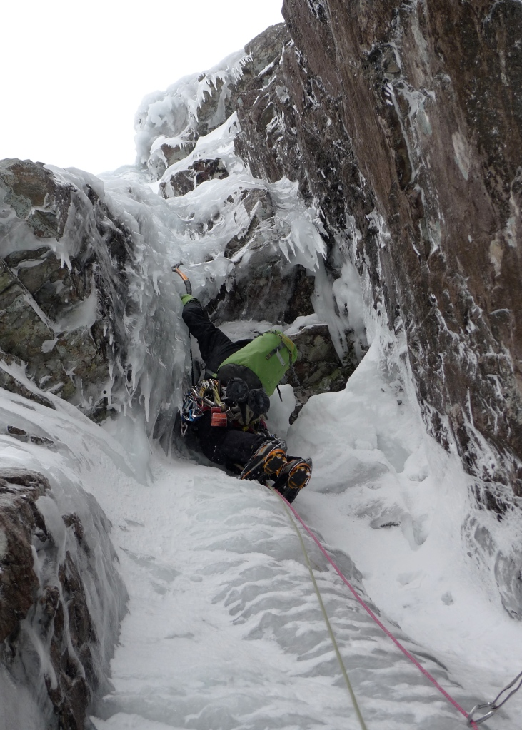 Rich Allen about to surmount the bulge that opens the way on the superb third pitch of Minus 1 Gully, Ben Nevis.