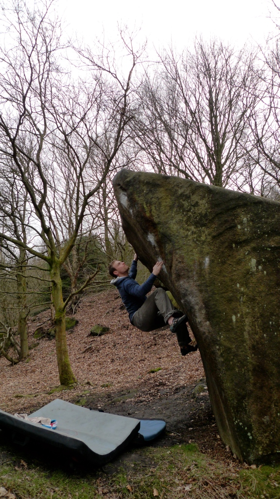 James Parkinson sporting the Arc'teryx Quiq Hoody whilst out bouldering at Caley Crag