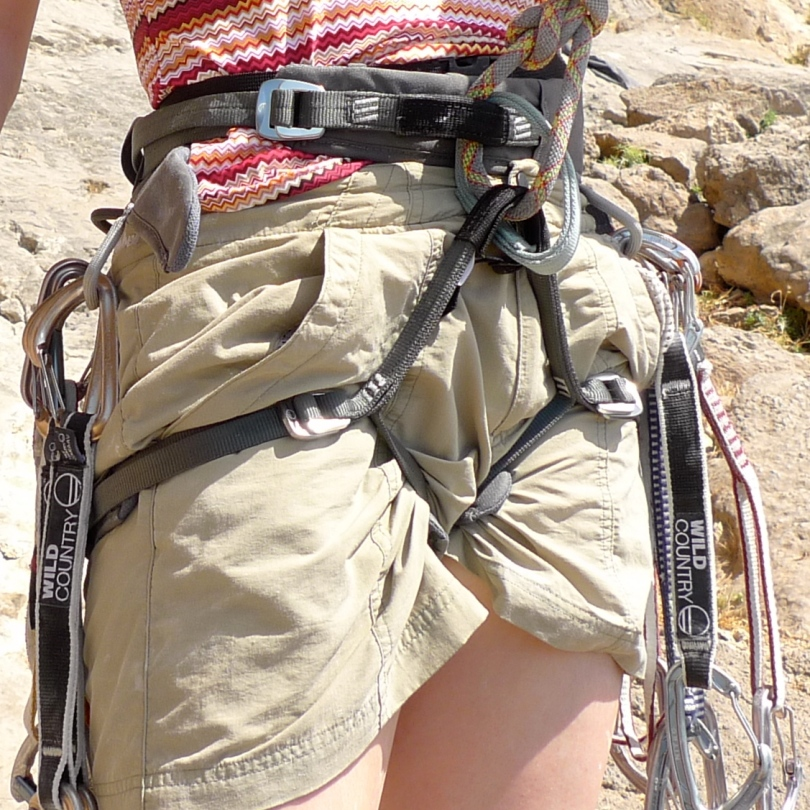 The Wild Country Aurora Women's Ziplock Harness is well equipped to carry lots of quickdraws. The only negative we found with this harness was that the excess waist band tended to pop out and hang down.