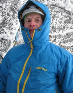 The author reaping the benefits of a decent belay parka, about to begin a frigid belay stint in the Cairngorms, Scotland.