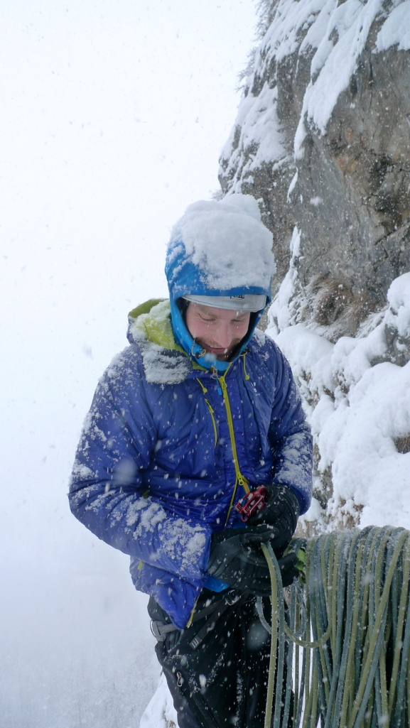 James Parkinson about to begin a potentially unpleasant belay stint in some dubious weather. The Haglofs Barrier Pro II Belay Jacket gets a thorough test!