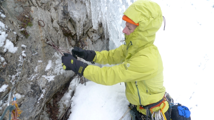 Testing the dexterity of the Outdoor Research Alpine Alibi II Glove on a cold day ice climbing in France.