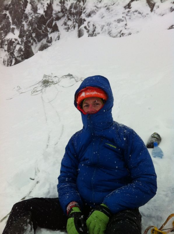 Warming up in my Patagonia DAS Parka after bailing from a route in bad weather.