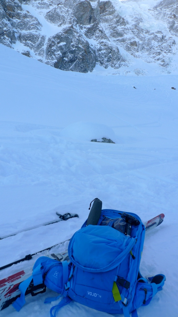 The Haglöfs VOJD 18 ABS Ski Pack, showing the shovel and probe being carried.
