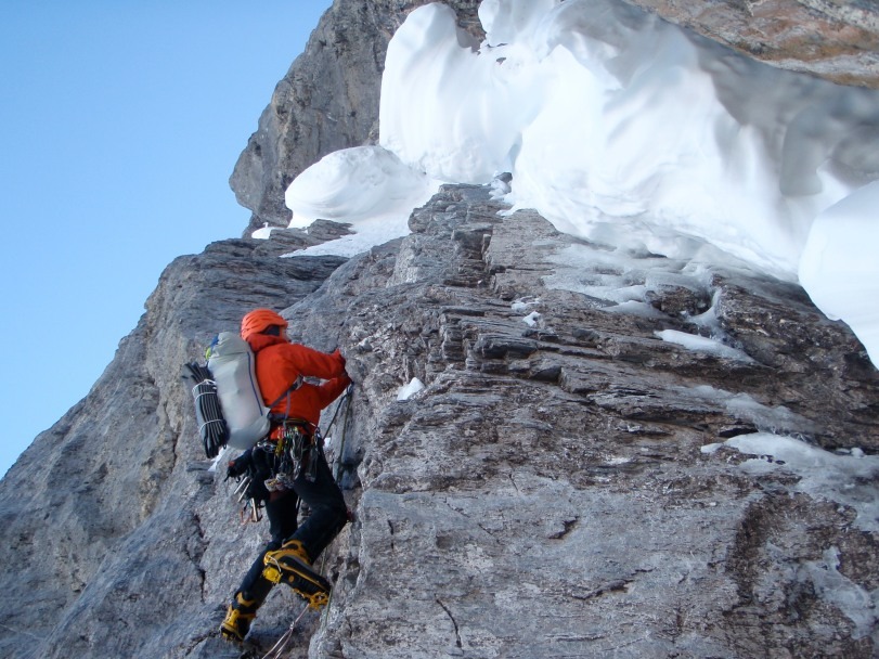 Arc'teryx Alpha Comp Hoody - great for technical climbing in cold, dry conditions. Here seen in action about to tackle the snow mushroom on the Ice Bulge pitch of the 1938 Route, Eiger North Face, Switzerland.