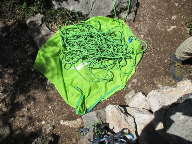 The detachable tarp was very useful. There is a strap to help keep it wrapped in the pack.