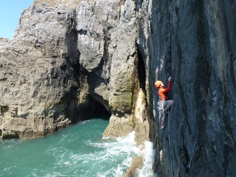Arc'teryx Morphic Zip Neck Long Sleeve Top - a great cut for climbing rock or ice. Here in use on the Pembrokeshire sea cliffs, South Wales.