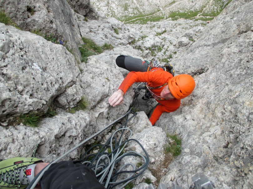 Arc'teryx Morphic Zip Neck Long Sleeve Top - great for rock climbing. Note the tougher fabric used on the forearm areas. In this photo Kev is climbing Trenke Crack on the First Sella Tower, Sella Group, Dolomites, Italy.