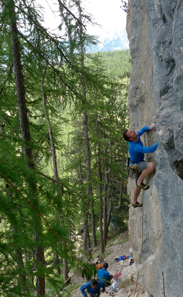 Haglöfs LIM Power Dry Hood - works well under a climbing harness and doesn't restrict movement. Unkown 7b at Tornoux.