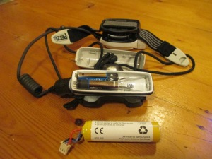 The battery compartment showing the massive battery and 2 emergency AAA batteries.