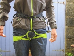 The pockets are set too low to work well with a harness