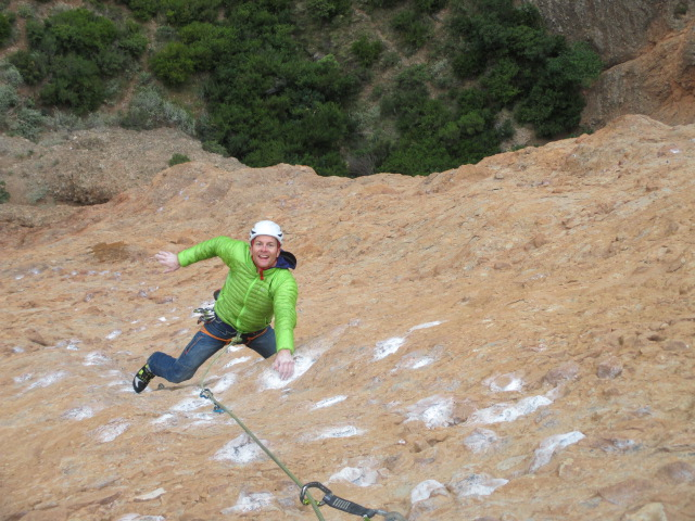 Climbing in the Arcteryx Cerium SL Jacket on a cold day in Riglos, Spain.