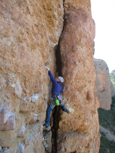The Arcteryx Cerium SL Jacket is great as a lightweight belay jacket. Seen here in it's integrated stuff sack, clipped to the back of my harness whilst climbing multi pitch routes in Riglos, Spain.