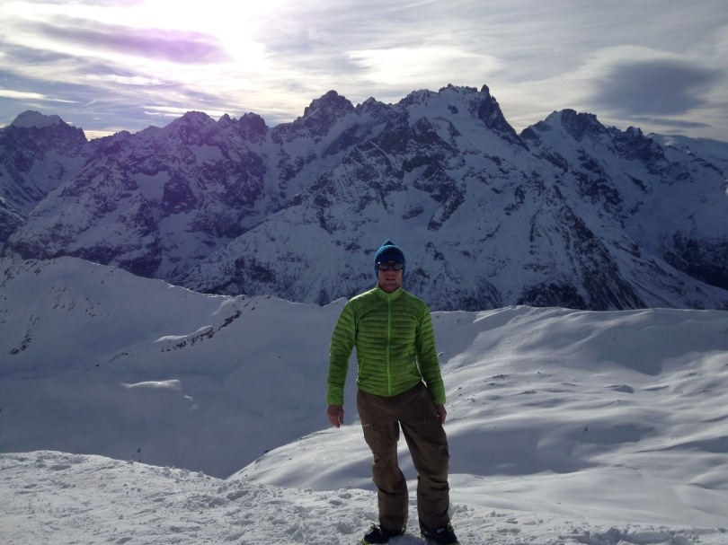 Wearing the Arcteryx Cerium SL Jacket whilst on a short summit stop, ski touring in the Ecrins, France.