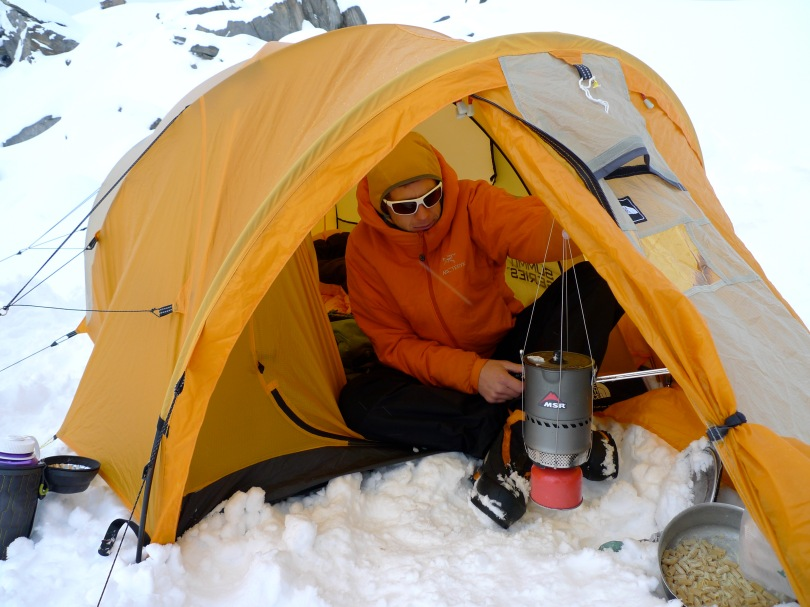MSR Reactor Stove - using the hanging kit to melt snow in the tent porch.