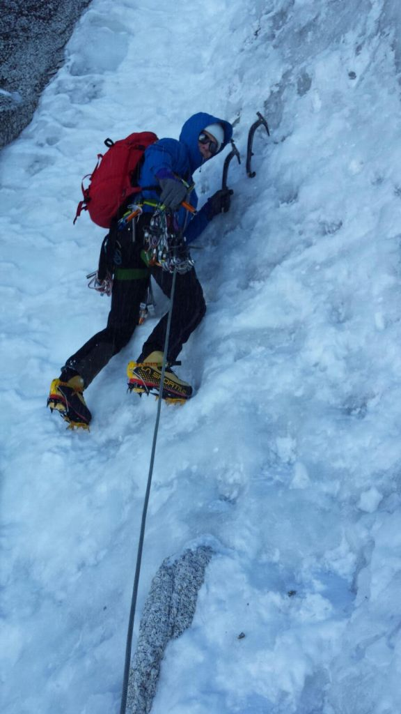 Stopping to place a Petzl Laser Speed Light Ice Screw on the Chere Couloir, Mont Blanc Du Tacul.