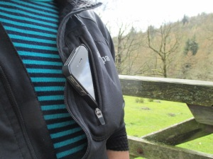 The small 'media' pocket was plenty big enough for my smartphone. It has a headphone slot on the inside.